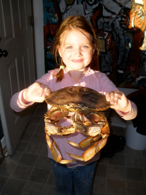 Can you see the pride on my big girl's face?  That is a live snapper she is bravely holding.